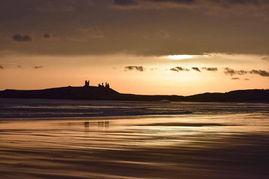Daybreak over Dunstanburgh Castle