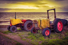 Old tractors on the beach