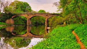 Railway bridge reflections