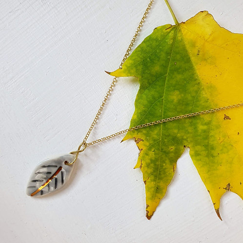 Sky blue porcelain leaf pendant with silver chain, small size
