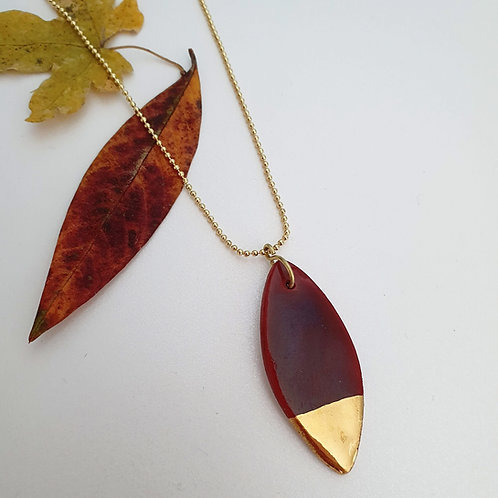 Burgundi porcelain leaf pendant dipped in gold, medium size