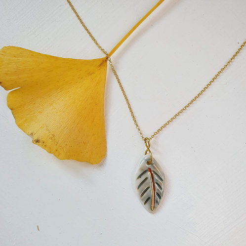 Stained green porcelain leaf pendant with silver chain, small size