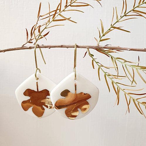 Porcelain earrings with golden fig leaf