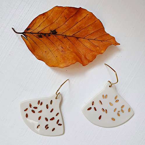 White porcelain earrings with gold leaves