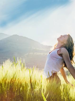 young-woman-outdoor-enjoying-the-sunligh