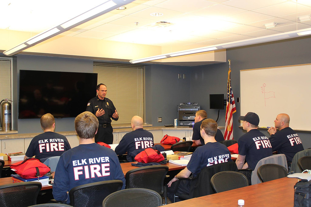 Fire Chief John Cunningham talks to students of his fire academy
