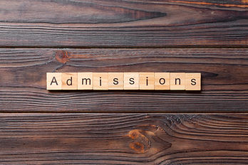 admissions word written on wood block. a