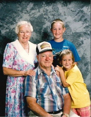 Derek and Ashley sharing a special moment with their grandparents.