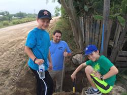 Kids installing water lines.jpg