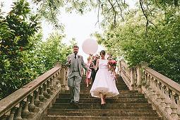 Bride and Groom with Bubblegum Balloons. York House, Twickenham. London Wedding Planner.