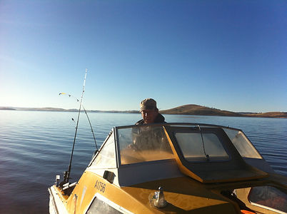 Rod Giles on his boat 'Zambezi' at Lake Eucumbene.JPG