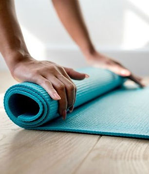 woman-rolling-up-blue-yoga-mat_edited.jp