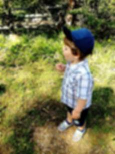 child with dandilion