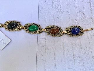 Vintage goldtone panel bracelet with lucite stones