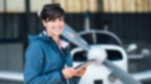 Confident female pilot in the hangar pre