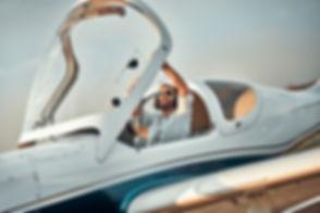 Pilot closing light aircraft cockpit at