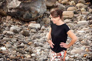 A lady wearing a black linen top made by Samook Designs