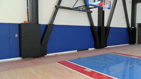 SportsVenuePadding.com |  University | Collegiate | High School | basketball court | CSUN | Post pads | wall padding | i-beam padding | Custom pads & mats