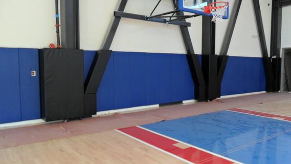 SportsVenuePadding.com |  University | Collegiate | High School | basketball court | CSUN | Post pads | wall padding | i-beam padding | Custom pads & mats