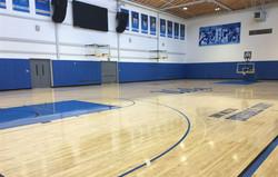 Indoor gymnasium wall padding