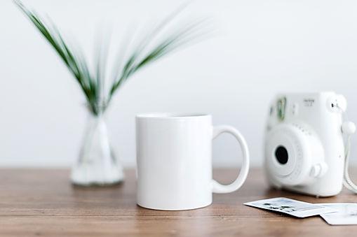 Kate Max paid white camera with mug.jpg