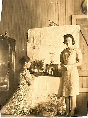Sebastiana kneeling in prayer, her daughter Eduarda (Lala) Rodriguez Leija standing near, Laredo, Texas, 1940s