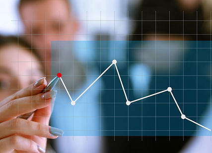 a-group-of-people-examines-the-financial-statistics-of-an-enterprise-pointing-with-a-hand-