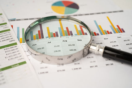 magnifying-glass-on-charts-graphs-paper.jpg