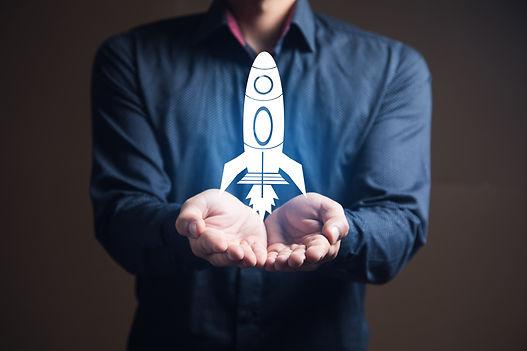 businessman-is-holding-a-rocket-startup-concept.jpg