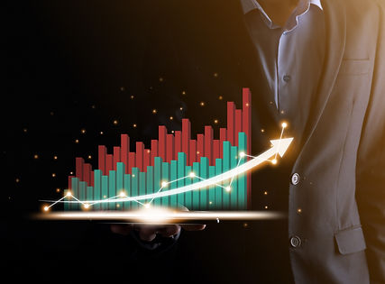 businessman-holding-and-showing-a-growing-virtual-hologram-of-statistics-graph-and-chart-w