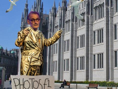 Sir Ian Diamond caught pretending to be a golden statue of himself