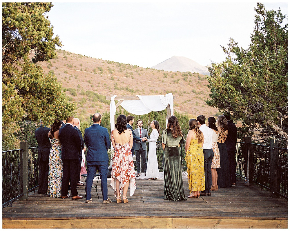 Moab Utah wedding ceremony in the La Sal mountains at Whispering Oaks