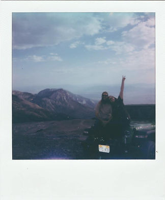 Polaroid photo of couple sitting on a jeep in Great Basin National Park