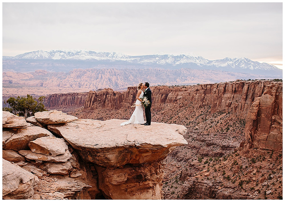 couple on the cliff eloping in Moab Utah on BLM land