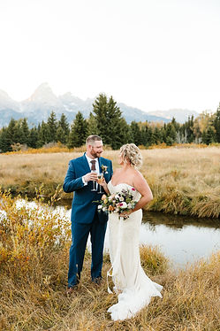 Grand Teton National Park elopement photography of couple drinking champange