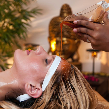 a-woman-has-a-soothing-ayurveda-massage-