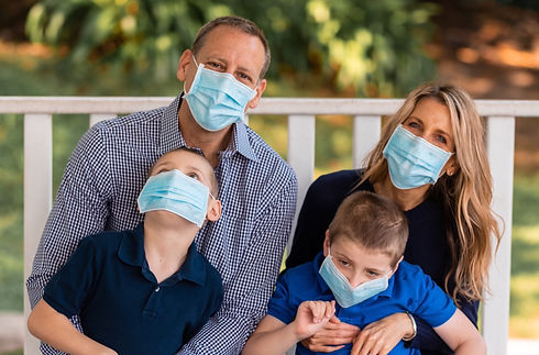 Danny, Nikki, Carson and Chase Miller, wearing their COVID-19 masks