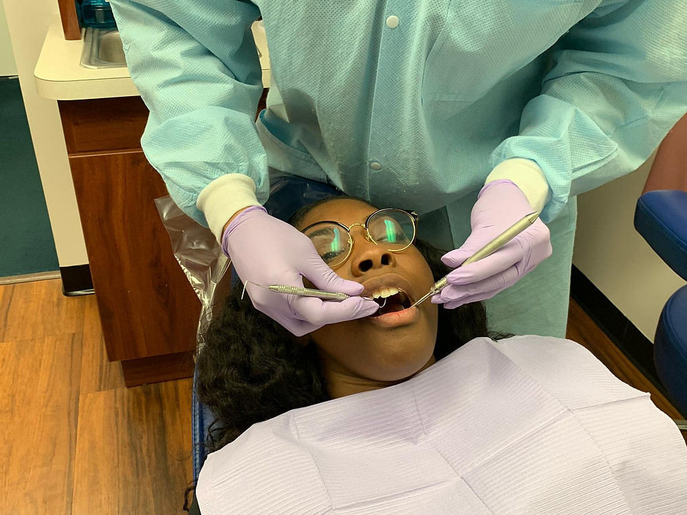 dentist is checking for abscessed tooth