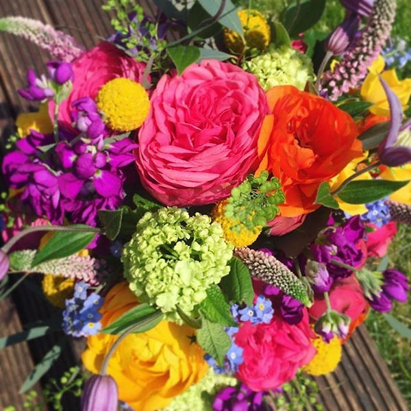 A bright and cheerful bouquet to match t
