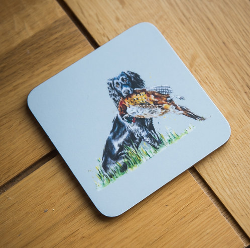 Cocker spaniel and a pheasant coaster
