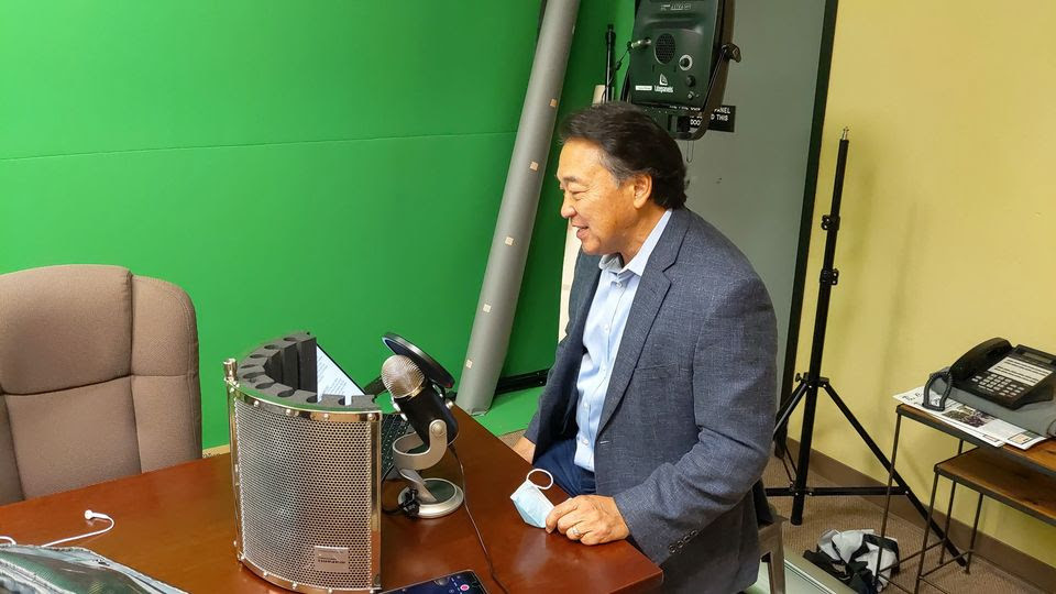 Auctioneer recording in the PRxDigital Production Studio for the auction.