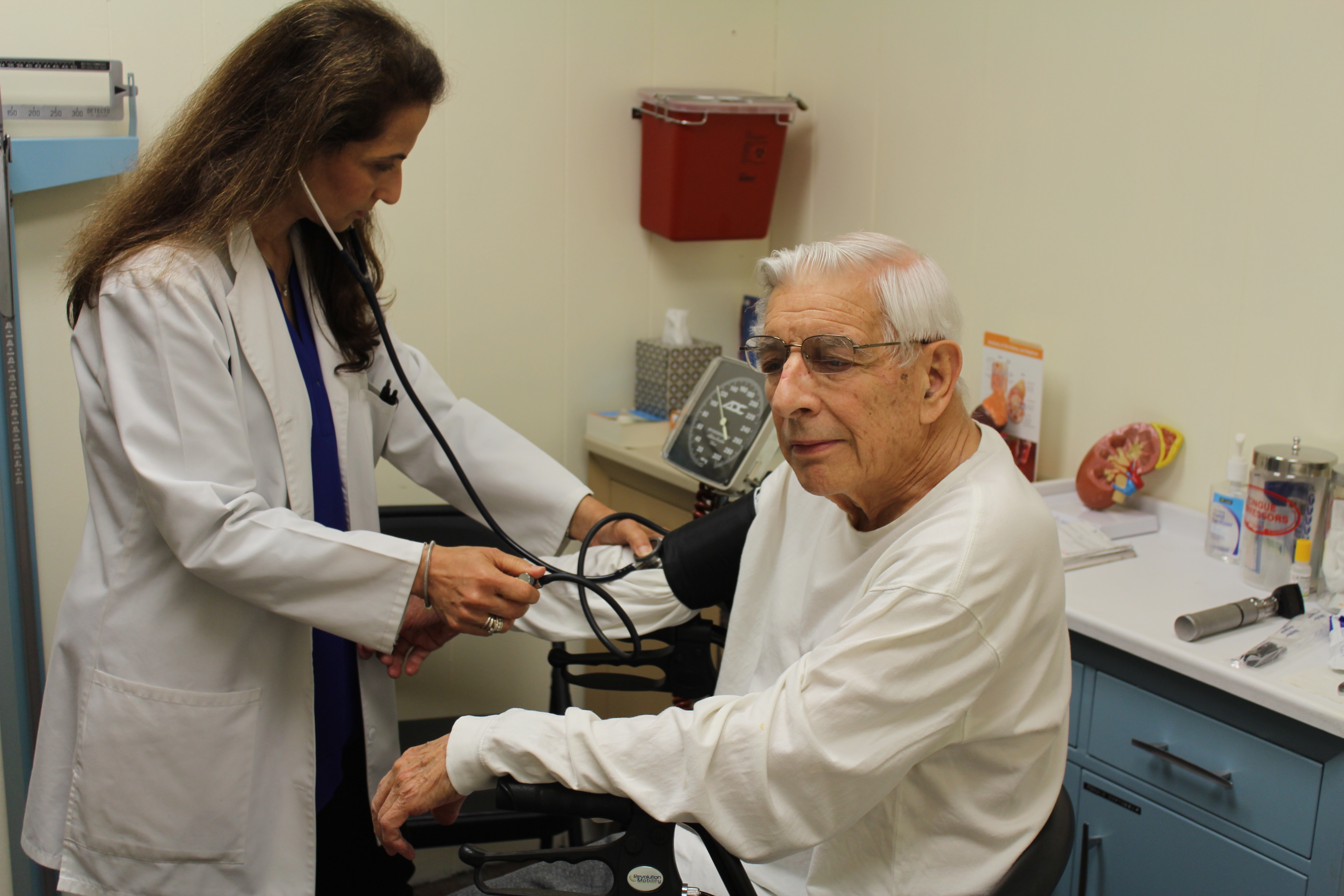 Nephrologist checking blood pressure