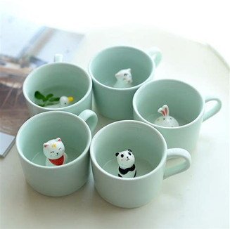 Hand a friend a cup of freshly brewed hot coffee.  The more they sip, the more the cuteness is revealed.  Inside each cup is a cute cat.  Such a novel idea.
