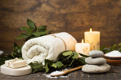 Towel candle and stone are on the table