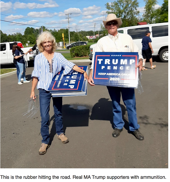 TRUMP SUPPORTERS WITH SIGNS.png
