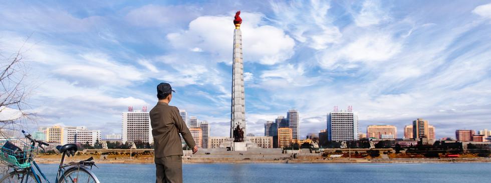 Man gazing at Juche Tower