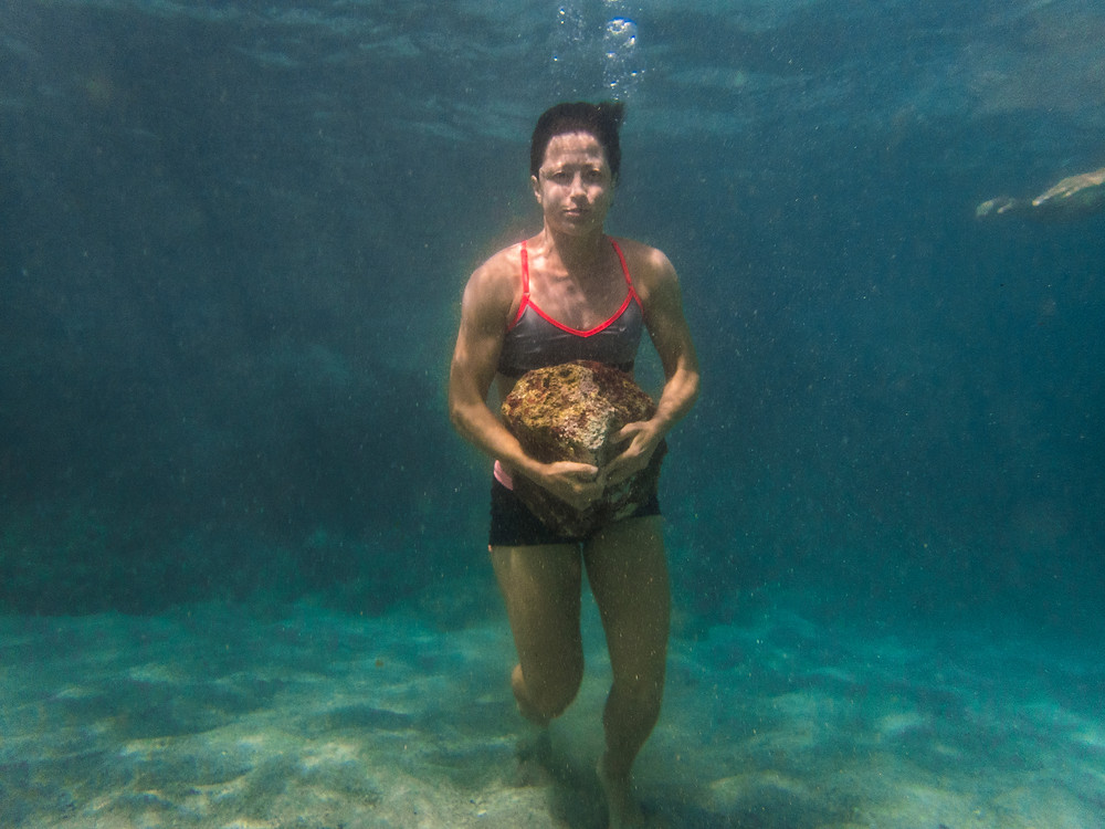 Underwater rock carry in Hawaii, representing the state of mind you are in the Infinitus race.