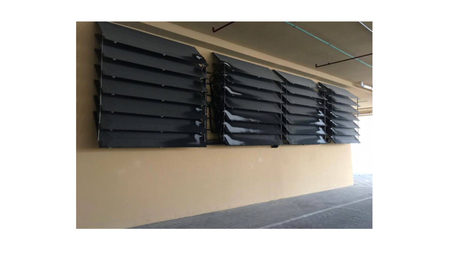 Energie SHW: Panels stacked in parking enclosure