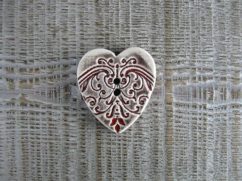 Bouton céramique en forme de coeur empreinte frise