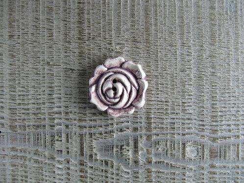 Bouton céramique rose en relief